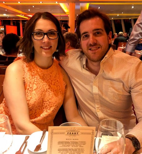 Aimee and her husband enjoy a fancy meal on a recent cruise