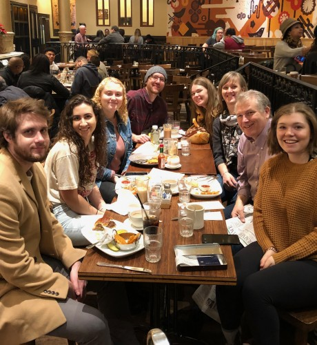 Cindy, her husband and their adult children enjoy a meal together in New York City.