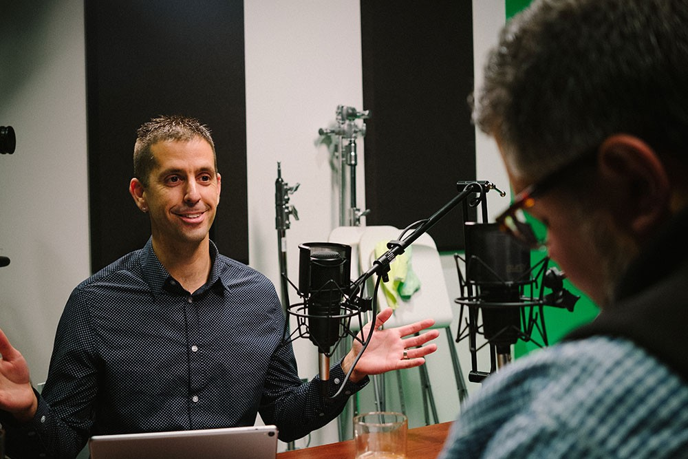Ryan Holland at podcast recording studio discussing Wireless Networking with Mike Hofherr