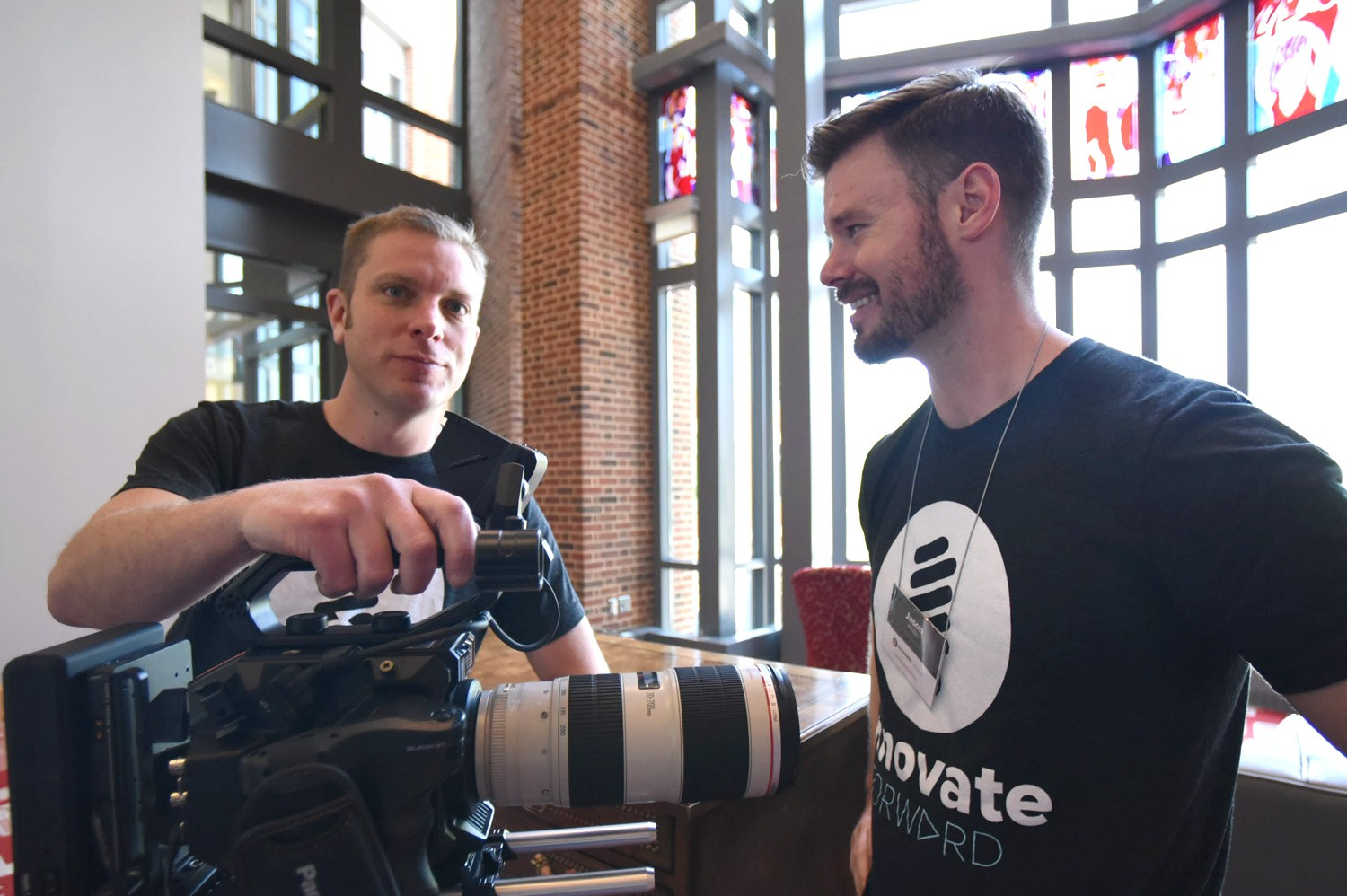 ODEE Media Services team members with camera at Innovate conference