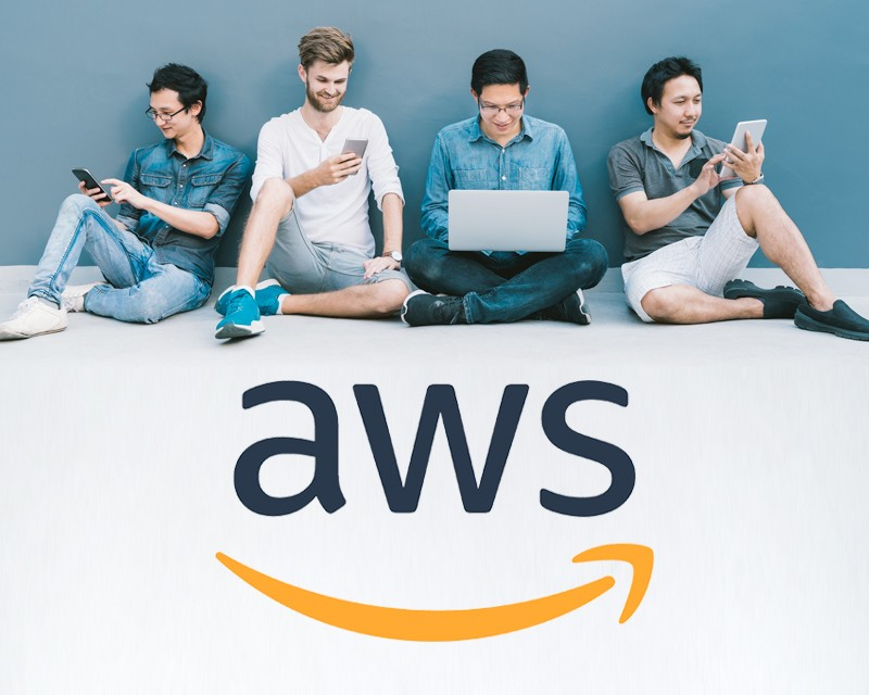 Group using technology with AWS logo