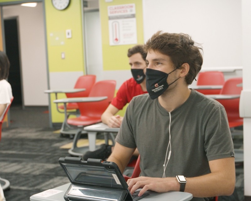 Students wearing masks and socially distancing in a classroom